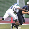 Legacy's quarterback Partrick Medina is tackled by Overland's Jordan Potts during Thursday's game at North Stadium.<br /> September 1, 2011<br /> staff photo/ David R. Jennings
