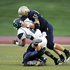 Legacy's Mike Blascoe and Connor Ayers sack Overland's quarterback Austin Conway during Thursday's game at North Stadium.<br /> September 1, 2011<br /> staff photo/ David R. Jennings