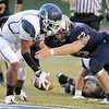 Legacy's Austin Yurko causes Overland's Xavier Claypool to fumble during Thursday's game at North Stadium.<br /> September 1, 2011<br /> staff photo/ David R. Jennings