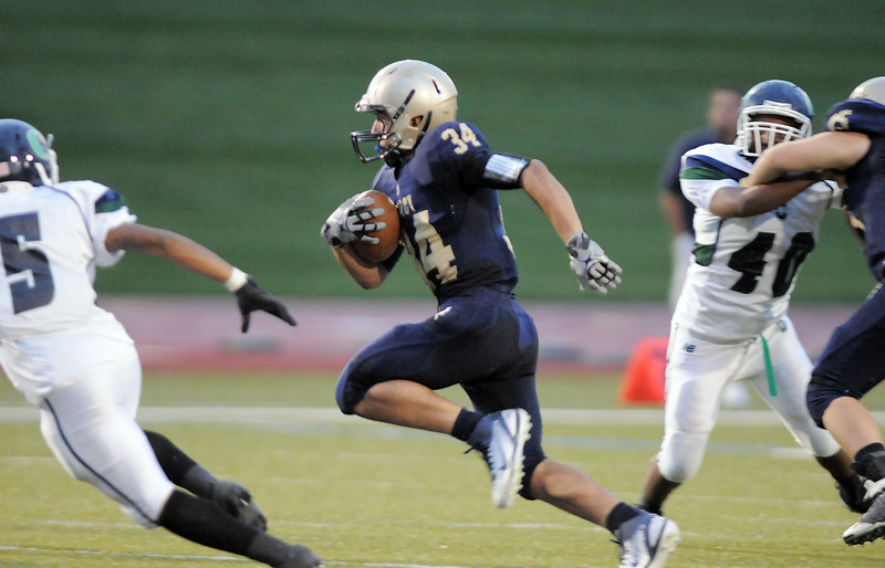 Legacy's Phydell Paris runs the ball against Overland during Thursday's game at North Stadium.<br /> September 1, 2011<br /> staff photo/ David R. Jennings
