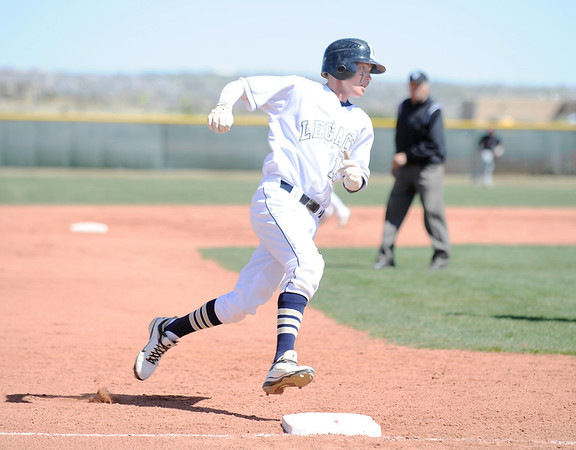 Legacy's Tyler Clapper ronds third base after making a hit against Pomona during Saturday's game at Legacy.<br /> April 7, 2012 <br /> staff photo/ David R. Jennings