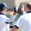 Legacy's Jakob Bublitz, left, gets a high five from ty Overboe after hitting a long ball against Pomona during Saturday's game at Legacy.<br /> April 7, 2012 <br /> staff photo/ David R. Jennings