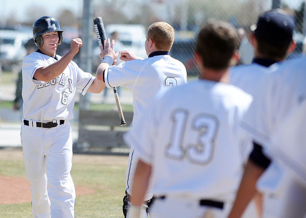 Legacy's Lucas Gilbreath, left, is congratulated by Ty Overboe after scoring a run against Pomona during Saturday's game at Legacy.<br /> April 7, 2012 <br /> staff photo/ David R. Jennings