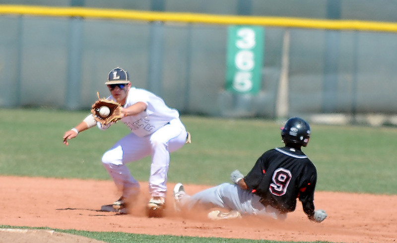 Legacy's Dylan Farrell forces Pomona's Kadeem Ahmad out at second base during Saturday's game at Legacy.<br /> April 7, 2012 <br /> staff photo/ David R. Jennings