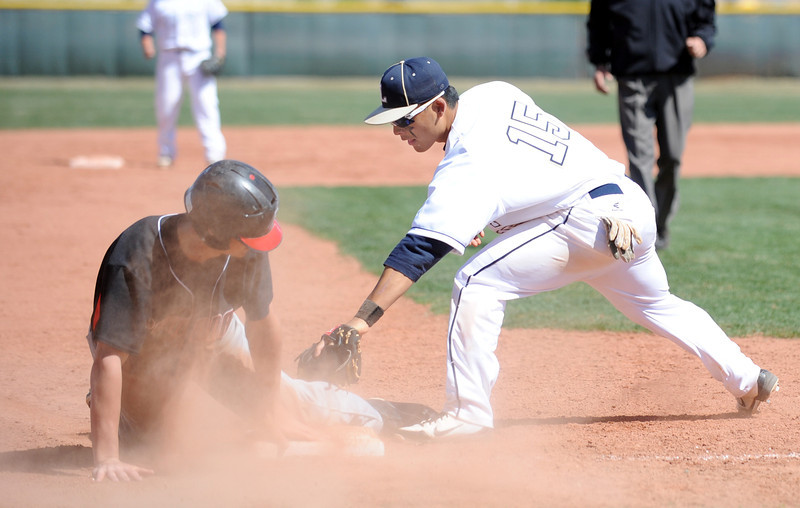 Legacy's Daniel Lee tries to tag out  Pomona's Nate Olinger at thrid base during Saturday's game at Legacy.<br /> April 7, 2012 <br /> staff photo/ David R. Jennings