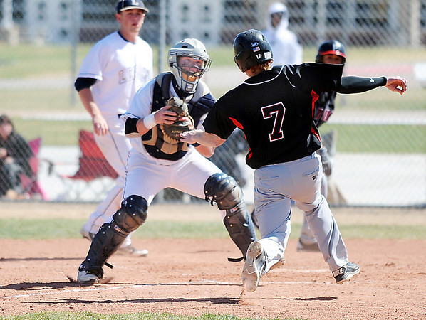 Legacy's catcher Ty Overboe tags out Pomona's Brandon Vogt at homeplate during Saturday's game at Legacy.<br /> April 7, 2012 <br /> staff photo/ David R. Jennings