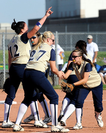 Legacy High School softball team, including pitcher Shelby Babcock, far left, celebrates mid-game at the at the Legacy vs. Ralston softball game on Friday, Aug. 28, 2009 at Ralston Valley High School. <br /> <br /> Photo by Mara Auster/Daily Camera