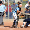 Legacy High School junior Buggs Torrez slides over home plate before Ralston Valley junior Mary Towner gets the ball at the Legacy vs. Ralston softball game on Friday, Aug. 28, 2009 at Ralston Valley High School. <br /> Photo by Mara Auster/Daily Camera