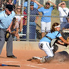 Ralston Valley junior Mary Towner, left, outs Legacy High School freshman Angelique Archuleta as she slides over home plate before gets the ball at the Legacy vs. Ralston softball game on Friday, Aug. 28, 2009 at Ralston Valley High School. <br /> <br /> Photo by Mara Auster/Daily Camera