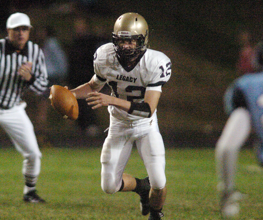 Legacy's quarterback Bradie Koch keeps the ball running it downfield against Ralston Valley during Friday night's game at the North Area Athletic Complex in Arvada.<br /> October 8, 2010<br /> staff photo/David R. Jennings