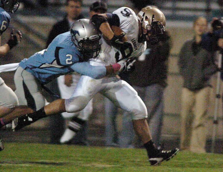 Legacy's Dezmon Fernandez carries the ball downfield while being tackled by Kyle Griffin, Ralston Valley, during Friday night's game at the North Area Athletic Complex in Arvada.<br /> October 8, 2010<br /> staff photo/David R. Jennings