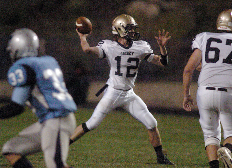 Legacy's quarterback Bradie Koch throws a pass against Ralston Valley during Friday night's game at the North Area Athletic Complex in Arvada.<br /> October 8, 2010<br /> staff photo/David R. Jennings