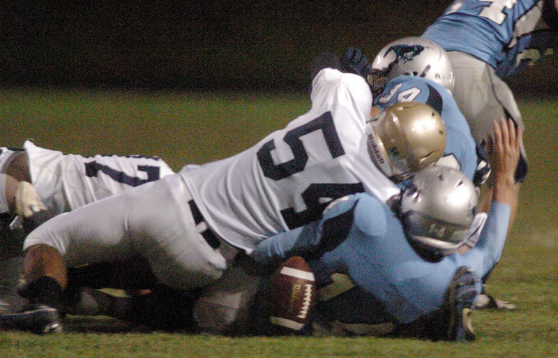Legacy's Skyler McWee forces a fumble from Ralston Valley's quarterback Nathaniel Wiemers during Friday night's game at the North Area Athletic Complex in Arvada. The fumble was recovered by Legacy.<br /> October 8, 2010<br /> staff photo/David R. Jennings