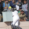 Legacy's catcher Kelsey Dempsey runs into to a power box trying to catch a Rock Canyon foul ball during the state 5A semifinal game on Saturday at the Aurora Sports Park.<br /> October 22, 2011<br /> staff photo/ David R. Jennings