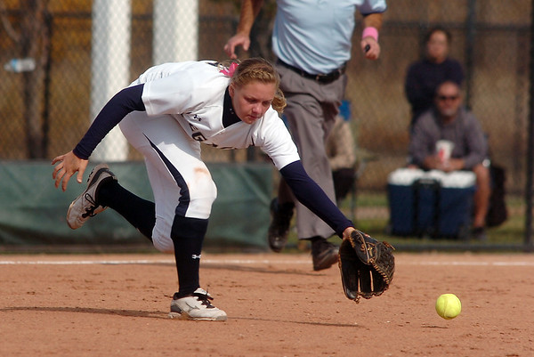 Legacy's Kylie Barnard, third base, reaches for an infield hit by Rock Canyon during the state 5A semifinal game on Saturday at the Aurora Sports Park.<br /> October 22, 2011<br /> staff photo/ David R. Jennings