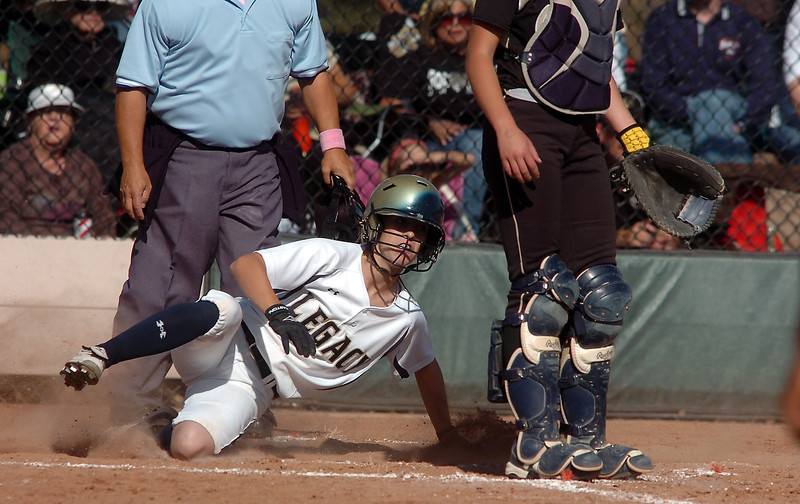 Legacy's Alyssa Geist slide to home plate past Rock Canyon catcher during the state 5A semifinal game on Saturday at the Aurora Sports Park.<br /> October 22, 2011<br /> staff photo/ David R. Jennings