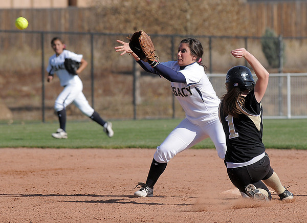 Legacy's shortstop Jessica Ball tags out  Rock Canyon's Taylor Dunn at second base during the state 5A semifinal game on Saturday at the Aurora Sports Park.<br /> October 22, 2011<br /> staff photo/ David R. Jennings