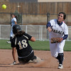 Legacy's Jessica Ball throws to first base after making a forced out of Rock Canyon's Lauren Paige during the state 5A semifinal game on Saturday at the Aurora Sports Park.<br /> October 22, 2011<br /> staff photo/ David R. Jennings