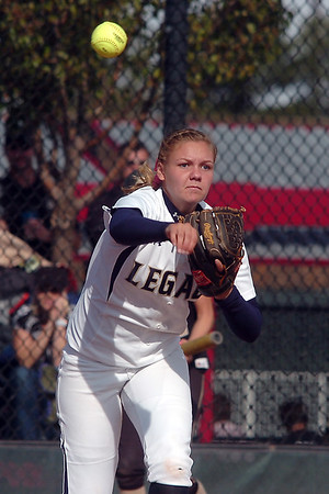 Legacy's Kylie Barnard throws to first base during the state 5A semifinal game against Rock Canyon on Saturday at the Aurora Sports Park.<br /> October 22, 2011<br /> staff photo/ David R. Jennings