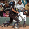 Legacy's Paige Reichmuth slides to home plate against Rock Canyon's catcher Zayne Blumberg during the state 5A semifinal game on Saturday at the Aurora Sports Park.<br /> October 22, 2011<br /> staff photo/ David R. Jennings