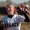 Legacy's Bekka Prokaski is congratulated after catching a Rock Canyon hit during the state 5A semifinal game on Saturday at the Aurora Sports Park.<br /> October 22, 2011<br /> staff photo/ David R. Jennings