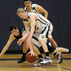 Mike Lehnerz, Legacy, fights for a loose ball with Dave Day, ThunderRidge during Tuesday's game at Legacy.<br /> February 23, 2010<br /> Staff photo/David R. Jennings