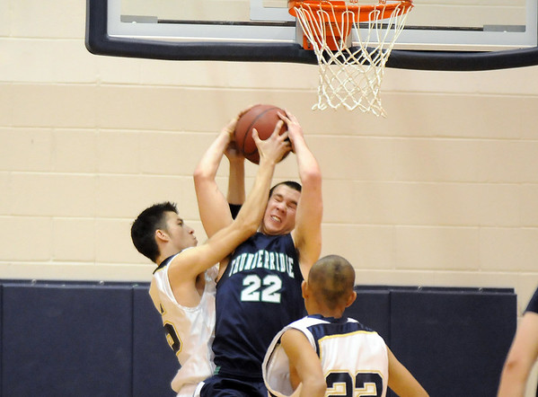 Justin Muench, Legacy, fights for the rebound against Josh Heikkila, ThunderRidge during Tuesday's game at Legacy.<br /> February 23, 2010<br /> Staff photo/David R. Jennings