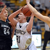 Legacy's Austyn Salazar goes to the basket past Fossil Ridge's Justin Dowd and Mike Solomon during Thursday's game at Legacy. <br /> January 27, 2013<br /> staff photo/ David R. Jennings