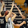 Legacy's Nathaniel Weber is caught between   Fossil Ridge's Andrew Semadeni and Sawyer Novak during Thursday's game at Legacy. <br /> January 27, 2013<br /> staff photo/ David R. Jennings