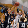 Legacy's Jeffrey Salazar shoots the ball against Fossil Ridge's Mike Solomon during Thursday's game at Legacy. <br /> January 27, 2013<br /> staff photo/ David R. Jennings