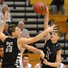 Legacy's Nathaniel Weber's pass is caught  against Fossil Ridge's Sawyer Novak, right, during Thursday's game at Legacy. <br /> January 27, 2013<br /> staff photo/ David R. Jennings