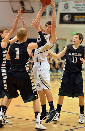 Legacy's Jesse Jacobsen catches the ball between of Fossil Ridge's Corey Peter and Evan Smith during Thursday's game at Legacy. <br /> January 27, 2013<br /> staff photo/ David R. Jennings