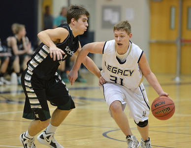Legacy's Austyn Salazar dribbles the ball downcourt against Fossil Ridge's Cody McCoy during Thursday's game at Legacy.  January 27, 2013 staff photo/ David R. Jennings