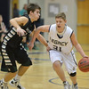 Legacy's Austyn Salazar dribbles the ball downcourt against Fossil Ridge's Cody McCoy during Thursday's game at Legacy. <br /> January 27, 2013<br /> staff photo/ David R. Jennings