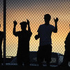 BE0906FOO09<br /> Legacy High fans watch the game against Mountain Range from the fence as they wait to get into the stadium during Friday night's game at North Stadium.<br /> Sept. 3, 2009<br /> Staff photo/David R. Jennings