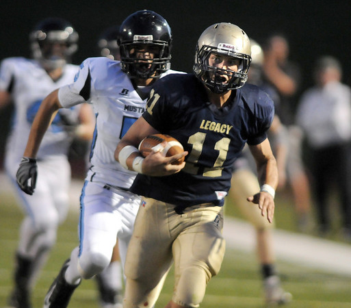 Legacy's Jake Levin stays ahead of Mountain Range's John Porricelli for a touchdown during Friday night's game at North Stadium.<br /> Sept. 3, 2009<br /> Staff photo/David R. Jennings