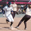 Legacy's pitcher Rainey Gaffin beats the ball to first base past Rock Canyon's Kaitlyn Miller during Saturday's championship game at the Aurora Sports Complex. Legacy defeated Rock Canyon 5-2.<br /> <br /> October 23, 2010<br /> staff photo/David R. Jennings