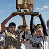 Buggs Torrez, left, and  Melissa Marcovecchio hold the state 5A championship softball trophy for Legacy's fourth championship in a row at the Aurora Sports Complex on Saturday. <br /> <br /> October 23, 2010<br /> staff photo/David R. Jennings