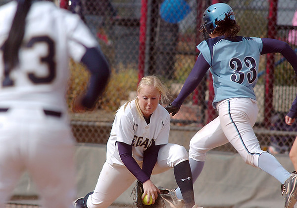 Legacy's Molly Madsen catches the ball thrown from third base by Marisa Cordova tagging out  Ralston Valley's Kelley Reeves during the state semi final 5A softball championship game on Saturday at the Aurora Sports Complex. <br /> <br /> October 23, 2010<br /> staff photo/David R. Jennings