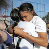 Legacy pitcher Rainey Gaffin hugs Jessica Garcia after winning the  state 5A softball championship on Saturday at the Aurora Sports Complex. <br /> <br /> October 23, 2010<br /> staff photo/David R. Jennings