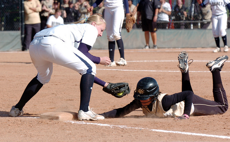 Legacy's Molly Madsen tags out a Rock Canyon player during Saturday's championship game against Rock Canyon at the Aurora Sports Complex. <br /> <br /> October 23, 2010<br /> staff photo/David R. Jennings
