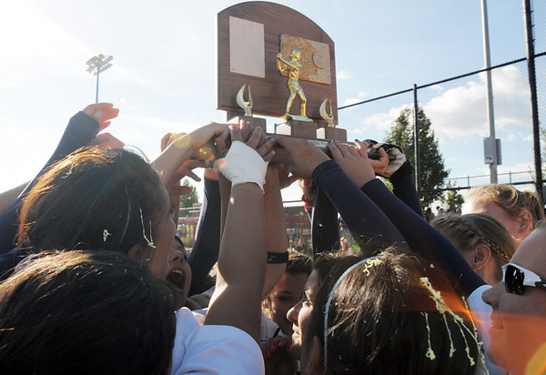 The Legacy team holds up the state 5A softball championship on Saturday at the Aurora Sports Complex. Legacy defeated Rock Canyon 5-2.<br /> <br /> October 23, 2010<br /> staff photo/David R. Jennings