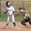 Legacy's Paige Reichmuth begins to run to third after Rock Canyon's Taylor Dunn chases after the ball at second base during Saturday's championship game against Rock Canyon at the Aurora Sports Complex. <br /> <br /> October 23, 2010<br /> staff photo/David R. Jennings
