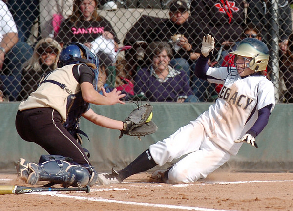 Melissa Marcovecchio, Legacy, slides to home trying get past Rock Canyon's Zanyne Blumberg during Saturday's championship game against Rock Canyon at the Aurora Sports Complex. <br /> <br /> October 23, 2010<br /> staff photo/David R. Jennings
