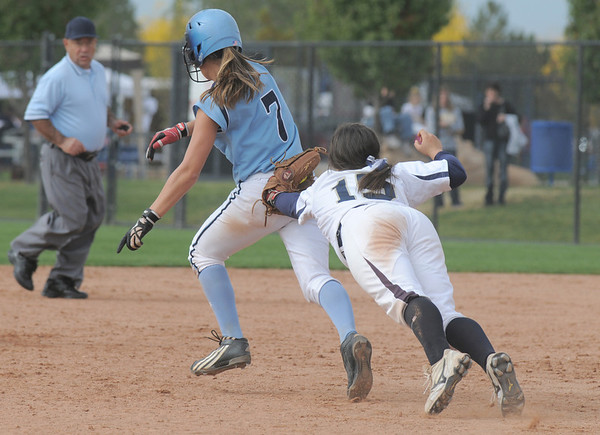 Legacy's Jessica Ball dives to tag out Mary Towner,  Ralston Valley, during the state semi final 5A softball championship game on Saturday at the Aurora Sports Complex. <br /> <br /> October 23, 2010<br /> staff photo/David R. Jennings