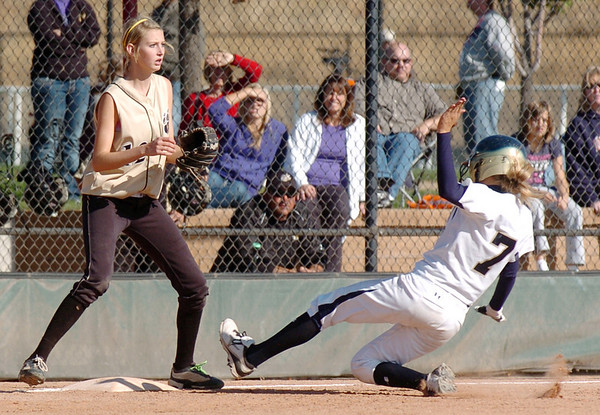 Rebeka Prokaski, Legacy, slides safely to third base past Rock Canyon's Brooke Wakefield during Saturday's championship game against Rock Canyon at the Aurora Sports Complex. <br /> <br /> <br /> October 23, 2010<br /> staff photo/David R. Jennings