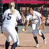 Legacy pitcher Rainey Gaffin tosses the ball to first baseman Molly Madsen to tag out Rock Canyon during Saturday's championship game against Rock Canyon at the Aurora Sports Complex. <br /> <br /> <br /> October 23, 2010<br /> staff photo/David R. Jennings