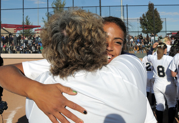 Legacy pitcher Rainey Gaffin hugs her mother and coach Dawn Gaffin after winning the state 5A softball championship game against Rock Canyon on Saturday at the Aurora Sports Complex. Legacy defeated Rock Canyon 5-2.<br /> <br /> October 23, 2010<br /> staff photo/David R. Jennings