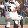 Legacy pitcher Rainey Gaffin and short stop Jessica Ball celebrate after winning the team's 4th state 5A softball championship on Saturday at the Aurora Sports Complex. Legacy defeated Rock Canyon 5-2.<br /> <br /> October 23, 2010<br /> staff photo/David R. Jennings