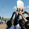 Legacy's seniors hold up the state trophy for the team after winning the  state 5A softball championship against Rock Canyon on Saturday at the Aurora Sports Complex. Legacy defeated Rock Canyon 5-2.<br /> <br /> October 23, 2010<br /> staff photo/David R. Jennings